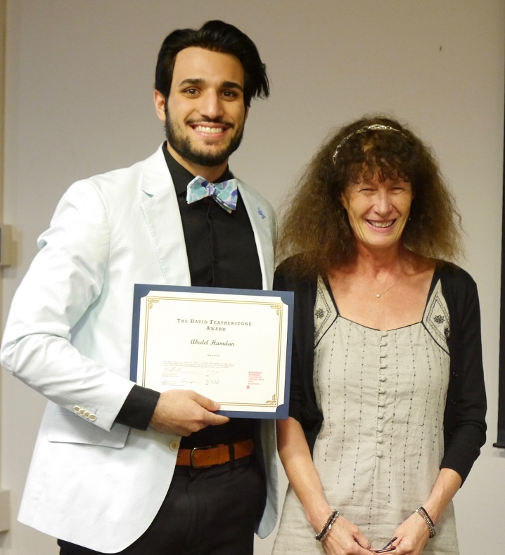 Hamdan receiving Featherstone Award from Dr. Richmond
