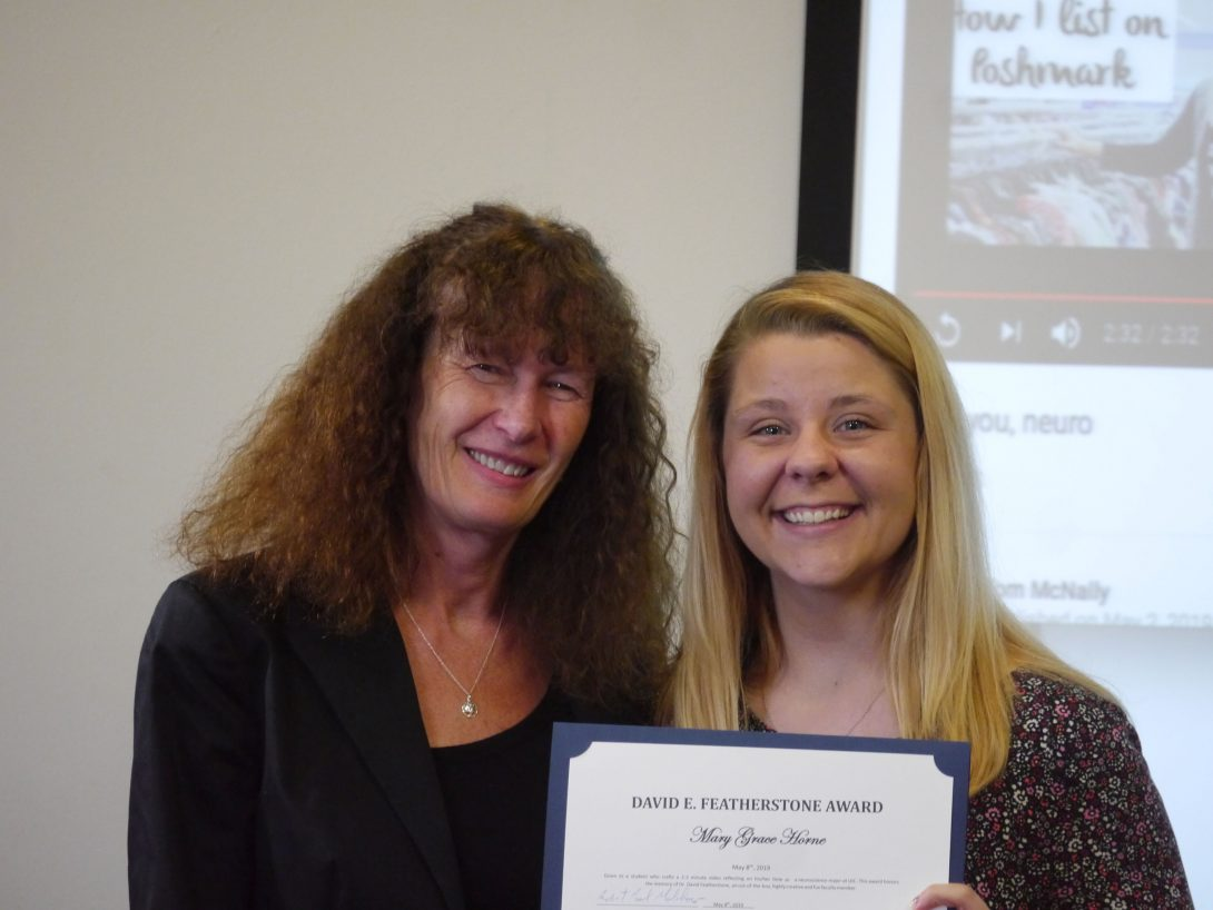 Horne receiving Featherstone Award from Dr. Richmond